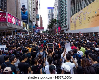 HONG KONG - JULY 7 2019: Hong Kong Protesters marching along the famous tourist spot Nathan Road against the controversial Extradition Bills that allow govt to send people to mainland China for trial.
