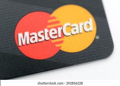 HONG KONG - JUN 15, 2015: Mastercard Credit Card Sign Close Up. Throughout the world, its principal business is to process payments between the banks of merchants and the card issuing banks.