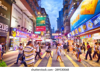 HONG KONG - JUN 7: Mong kok at night on June 7, 2015 in Hong Kong. Mong kok is characterized by a mixture of old and new multi-story buildings, with shops and restaurants at street level.
