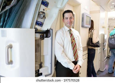 HONG KONG -JUNE 04: Emirates crew member meet passengers in Airbus A380 on June 04, 2014 in Hong Kong, China. Emirates handles major part of passenger traffic and aircraft movements at the airport.