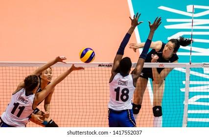 Hong Kong - June 06 2019: Zhu Ting of China (R) hits the ball during the FIVB Volleyball Nations League Hong Kong match between China and Italy.