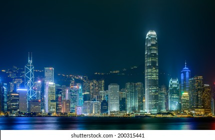 HONG KONG - June 14: Hong Kong city skyline at night over Victoria Harbor June 14 2014. Victoria Harbour is a natural landform harbour situated between Hong Kong Island and Kowloon in Hong Kong.