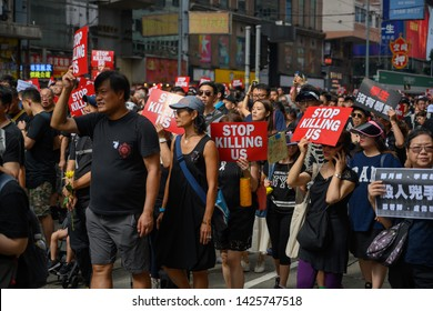 HONG KONG - June 16, 2019: Hong Kong June 16 protest against extradition bill with two million of people on the street. The paper they are holding said don't kill me.