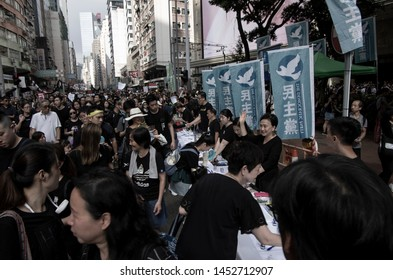 HONG KONG - JUNE 16 2019: former legislator Emily LAU waving at protesters at her party's counter during the protest against the controversial Extradition Bills
