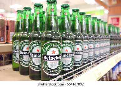 HONG KONG - JUNE 25, 2011: Bottles of beer put on a rack of a supermarket in Hong Kong. Editorial Use Only.