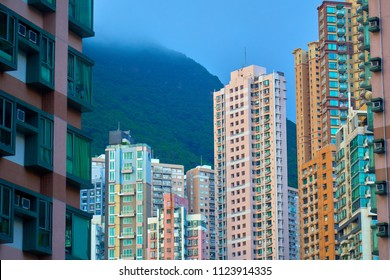 HONG KONG - JUNE 30, 2018: Spectacular view of Hong Kong Housing in front of forest hills.