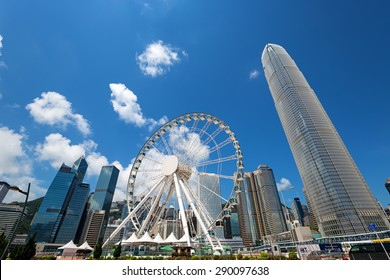 Hong Kong - June 4 2015: Day and night time views of the spectacular Victoria Harbour on the 60-metre high. The Hong Kong Observation Wheel at the New Central Harborfront, Central District, Hong Kong
