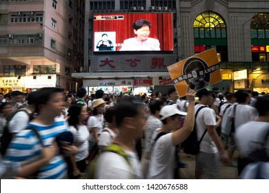 HONG KONG - JUNE 9, 2019: Protesters urged Chief Executive Carrie Lam to stand down after her proposal of a controversial extradition bill. Thousands of protesters marched against it.