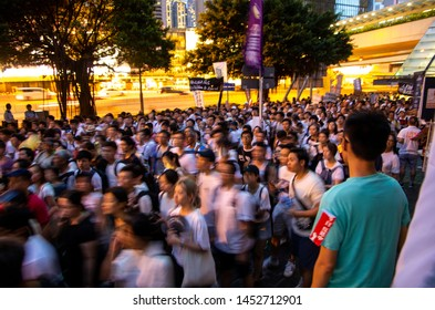 HONG KONG - JUNE 9 2019: one million Hong Kong people, mostly in white, protesting against the controversial Extradition Bills that allow HK govt to send people back to mainland China for trial.
