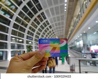 Hong Kong - Mar 28, 2017. Hand holding an Octopus Smartcard at Hong Kong International Airport.