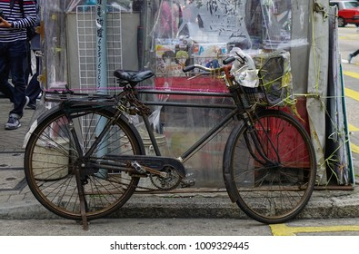 Hong Kong - Mar 29, 2017. An old bicycle on street in Hong Kong. Hong Kong has had the highest degree of economic freedom in the world.