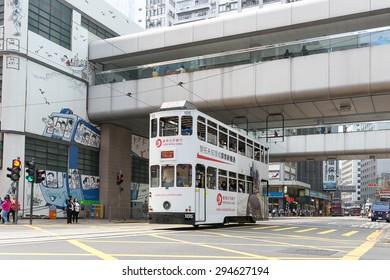 HONG KONG - MAR 29 : Trams running through under the bridge on Mar 29,2015 in HONG KONG