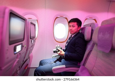 HONG KONG - MARCH 09, 2015: Emirates Airbus A380 economy class passenger. Emirates handles major part of passenger traffic and aircraft movements at the airport.