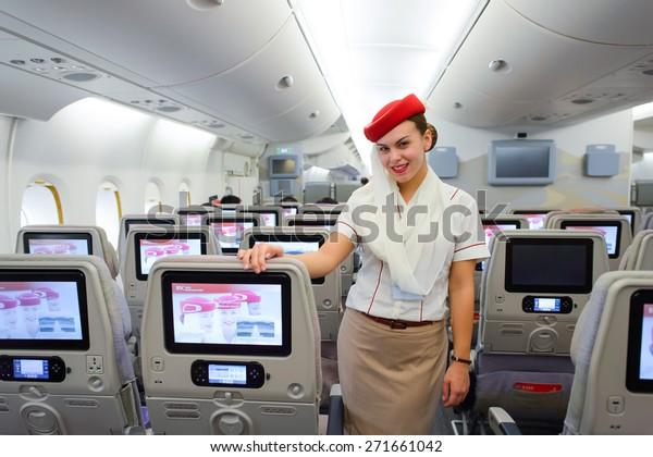HONG KONG - MARCH 10, 2015: Emirates Airbus A380 crew member. Emirates handles major part of passenger traffic and aircraft movements at the airport.