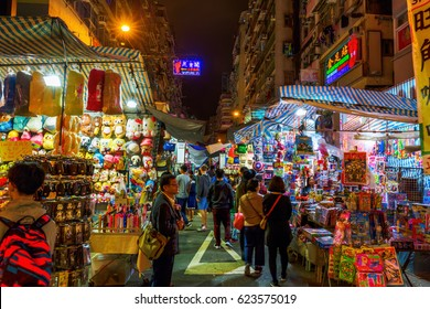 Hong Kong, Hong Kong - March 11, 2017: market scene at Temple Street with unidentified people. The street is known for its night market and as one of the busiest night flea markets in the territory