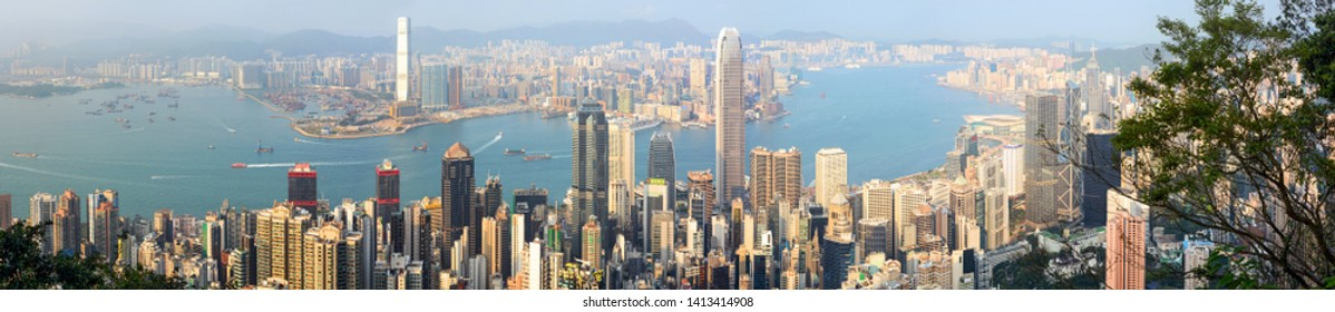 Hong Kong - March 11, 2019 - Panoramic view of Hong Kong's Victoria Harbour and energetic Central business district