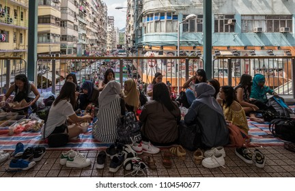 Hong Kong - March 15 2018: The Indonesian maid are gathering on the bridge in Mongkok during holiday.