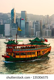 HONG KONG - MARCH 15: Victoria Harbor on March 15, 2013 in Hong Kong. Old Cruise Ship  departed from Ocean Terminal and drove across Victoria Harbor.