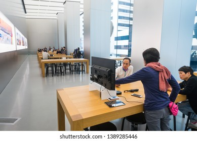 HONG KONG - MARCH 16, 2017: People in the Apple Store at Genius Bar. As of 2014, Apple employs 72,800 permanent full time employees, maintains 437 retail stores in fifteen countries.