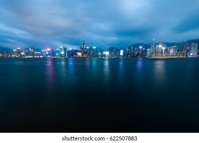 HONG KONG - MARCH 16, 2017: Night view of Hong Kong Island and Victoria Harbour from the Avenue of Stars in Tsim Sha Tsui.
