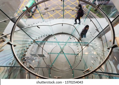 HONG KONG - MARCH 17, 2017: People at the three storey flagship Apple store in Hong Kong, the first official one, located in the IFC Mall.