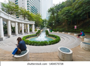 HONG KONG - MARCH 17, 2017: People in Hong Kong park. It is a public park, covering an area of 80,000 m2 and is an example of modern design and facilities blending with natural landscape.