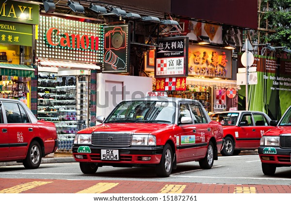 HONG KONG - MARCH 19: Taxis on the street on March 19, 2013 in Hong Kong. Over 90% daily travelers use public transport. Its the highest rank in the world.