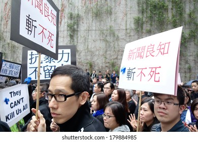 """HONG KONG - March 2: Hongkongers with slogan """"conscience of press won't die"""" and 13000 others march to support Kevin Lau Chun-To, Ming Pao ex-editor, and press freedom on March 2, 2014 in Hong Kong."""