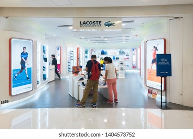 HONG KONG - MARCH 20, 2017: Lacoste store at the iSquare shopping centre. Lacoste is a French company selling clothing, footwear, sportswear, eyewear, leather goods, perfume, towels and watches.