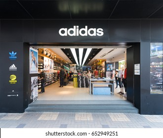 HONG KONG - MARCH 20, 2017: The facade of the Adidas store in Tsim Sha Tsui. Adidas AG is a German corporation, the largest sportswear manufacturer in Europe and the second biggest in the world.