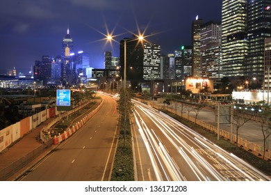 HONG KONG - MARCH 28: cars run on the highway around the downtown at night  in Hong Kong Island on March 2013. One of the world's top city skylines, supporting the Hong Kong tourism