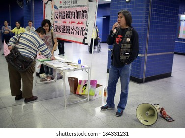 """HONG KONG, MARCH 29: Leung Kwok-hung, known as """" Long hair """", protest for train price increasing in Tai wan MTR station on 29 March 2014. he is a famous politician of League of Social Democrats party,"""