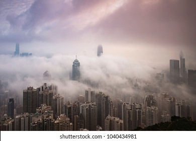 Hong Kong - March 3 2018: The fog over Victoria Harbor in early morning viewed from the Peak.