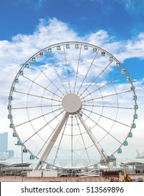HONG KONG - MARCH 31: The Hong Kong Observation Wheel, a 197 ft tall giant ferris wheel overlooking Victoria Harbor March 31, 2015. Low fog obscures part of the harbor on this day.