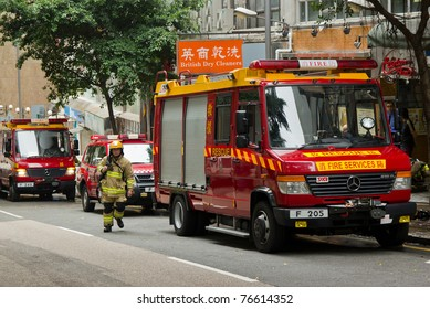 HONG KONG - MAY 02: Firemen and fire trucks arrive in morning on May 02, 2011 in Chai Wan, Hong Kong, China. A 19-year-old woman died and three people were injured in the fire.