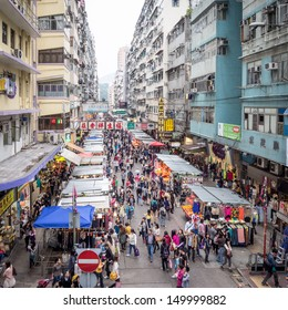 HONG KONG - MAY 04: Crowded market stalls in old district on March 04, 2013 in Hong Kong. With land mass of 1104 km and 7 million people, Hong Kong is one of most densely populated areas in the world.