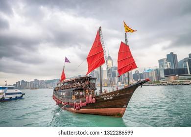 HONG KONG - MAY 12, 2014: The Aqua Luna sail around Victoria Harbour. The Aqua Luna Tsai, is a Chinese Junk operating in Victoria Harbour.