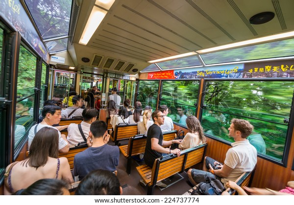 HONG KONG - MAY 12, 2014: Peak Train takes passengers to Victoria Peak. The peak is one of the most famous city attractions.