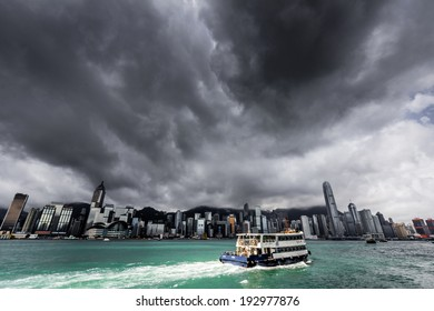 HONG KONG - MAY 15, 2014: View of Victoria harbor just before a tropical cyclone. During summer, typhoons regularly skirt the city, causing varying degrees of damage including injuries and deaths.