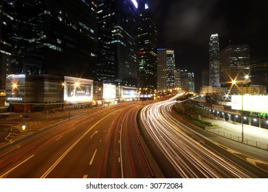 HONG KONG - MAY 16: Cars racing through downtown during the night on May 16, 2009 in Hong Kong. Hong Kong Island comprises the financial district whereas Kowloon serves as the traditional Chinese part