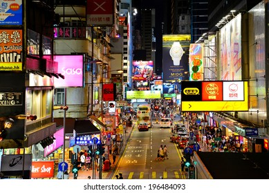 HONG KONG - MAY 17 : Mongkok at night on May 17, 2014 in Hong Kong. Mongkok is characterized by a mixture of old and new multi-story buildings, with shops and restaurants at street level.