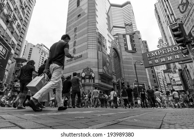HONG KONG - MAY 18, 2014: People walking through busy streets close to Times Square in Causeway Bay are in Hong Kong. With 7M population, it is one of the most dense areas in the world.