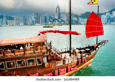 HONG KONG - MAY 18: Traditional chinese-style tourist junk sailing in Hong Kong harbor on May 18, 2013. Overall visitor arrivals to Hong Kong in 2012 totalled just over 38 million
