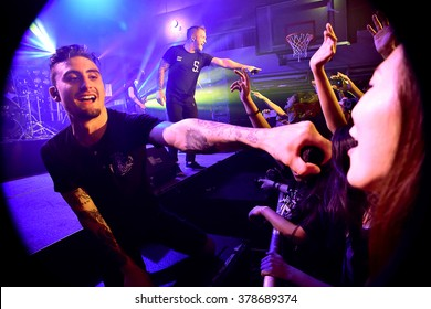 HONG KONG - May 22, 2015: We Came As Romans show, Vocalist Kyle Pavone hanged microphone to the fan to sing along