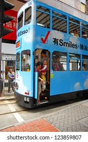HONG KONG - MAY 23: Unidentified lady with a child get off the Hong Kong tram in Tong Shui Road. The tram system is a major tourist attraction and operates since 100 years. May 23, 2007 Hong Kong