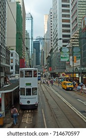 HONG KONG – MAY 28, 2008: old tram and city life in Des Voeux road Central. Beautiful and crowded part of the town.