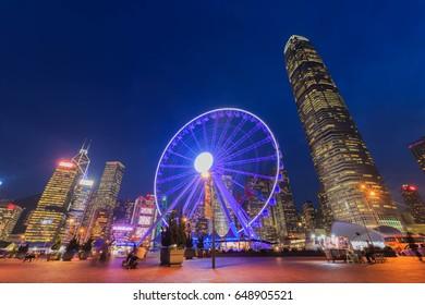 HONG KONG - May 28,2017 : the popular Hong Kong Observation Wheel in Hong Kong island at night near Ferry Pier arera with landmark buildings in Hong Kong