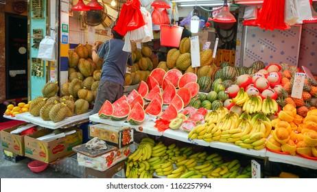 Hong Kong - May 3rd 2018: A variety of tropical fruits displayed by vendor.