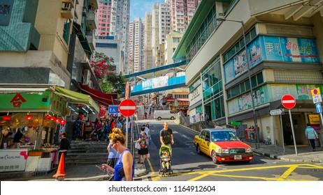 Hong Kong - May 3rd 2018: Streets of Hong Kong with people engaging in daily activity on Sunday.