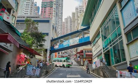 Hong Kong - May 3rd 2018: Streets of Hong Kong with people engaging in daily activity on Sunday morning.